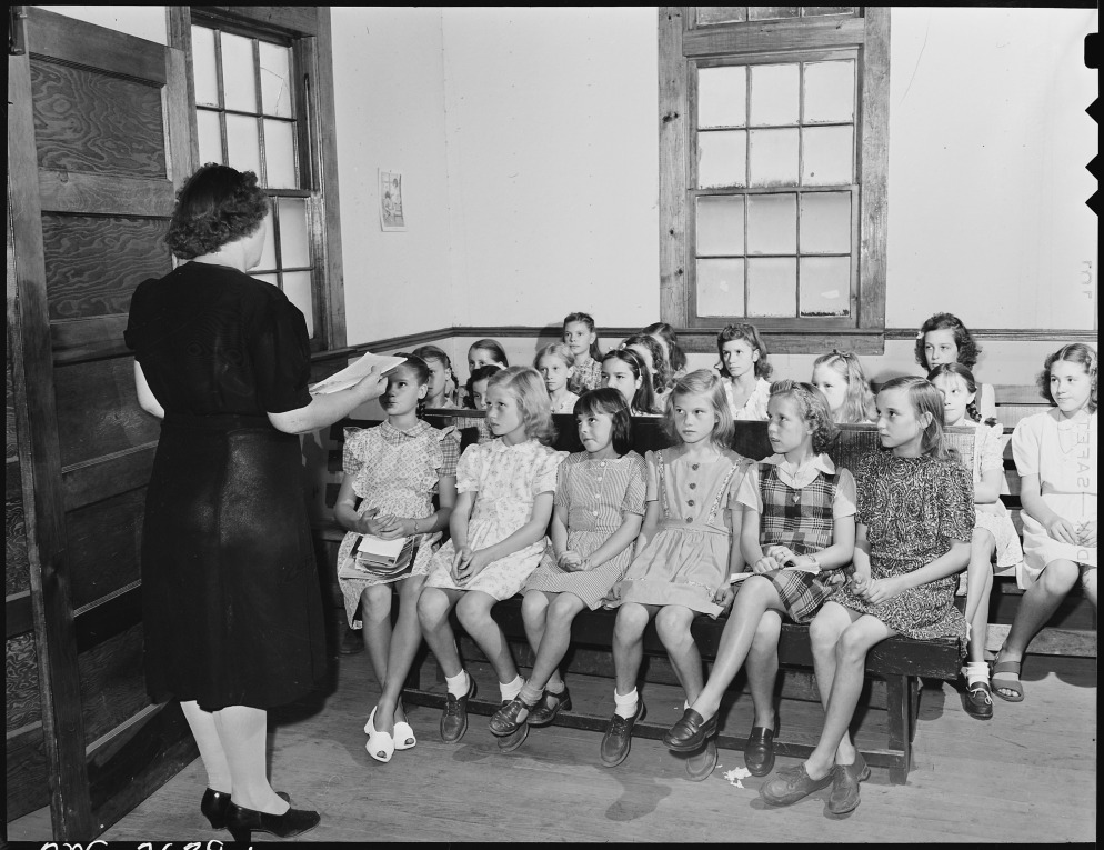 Sunday_school_at_the_Baptist_church_which_is_not_on_company_property_and_was_built_by_the_miners._Lejunior,_Harlan..._-_NARA_-_541342